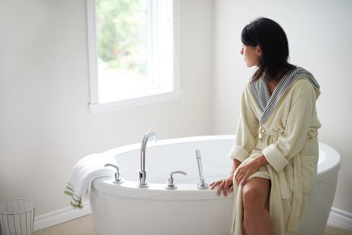 Woman Sitting By a Bathtub - Bathroom Remodel Escondido