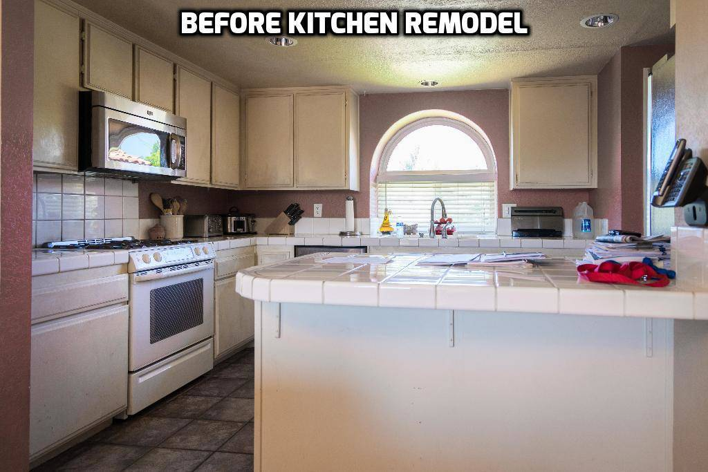 old kitchen cabinets with white tile countertops