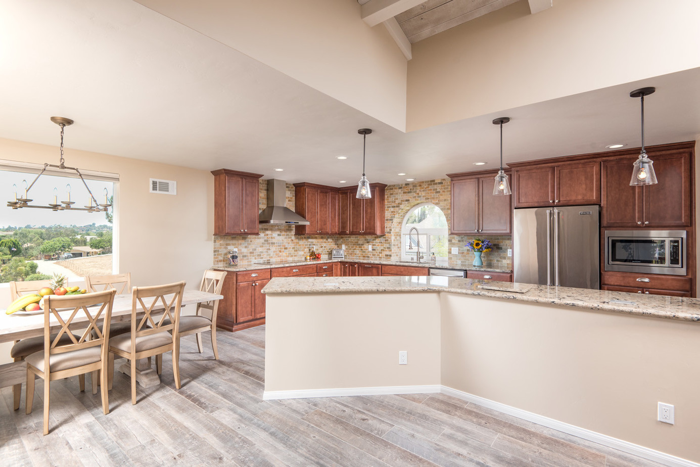 large L shaped kitchen with long bar height countertop