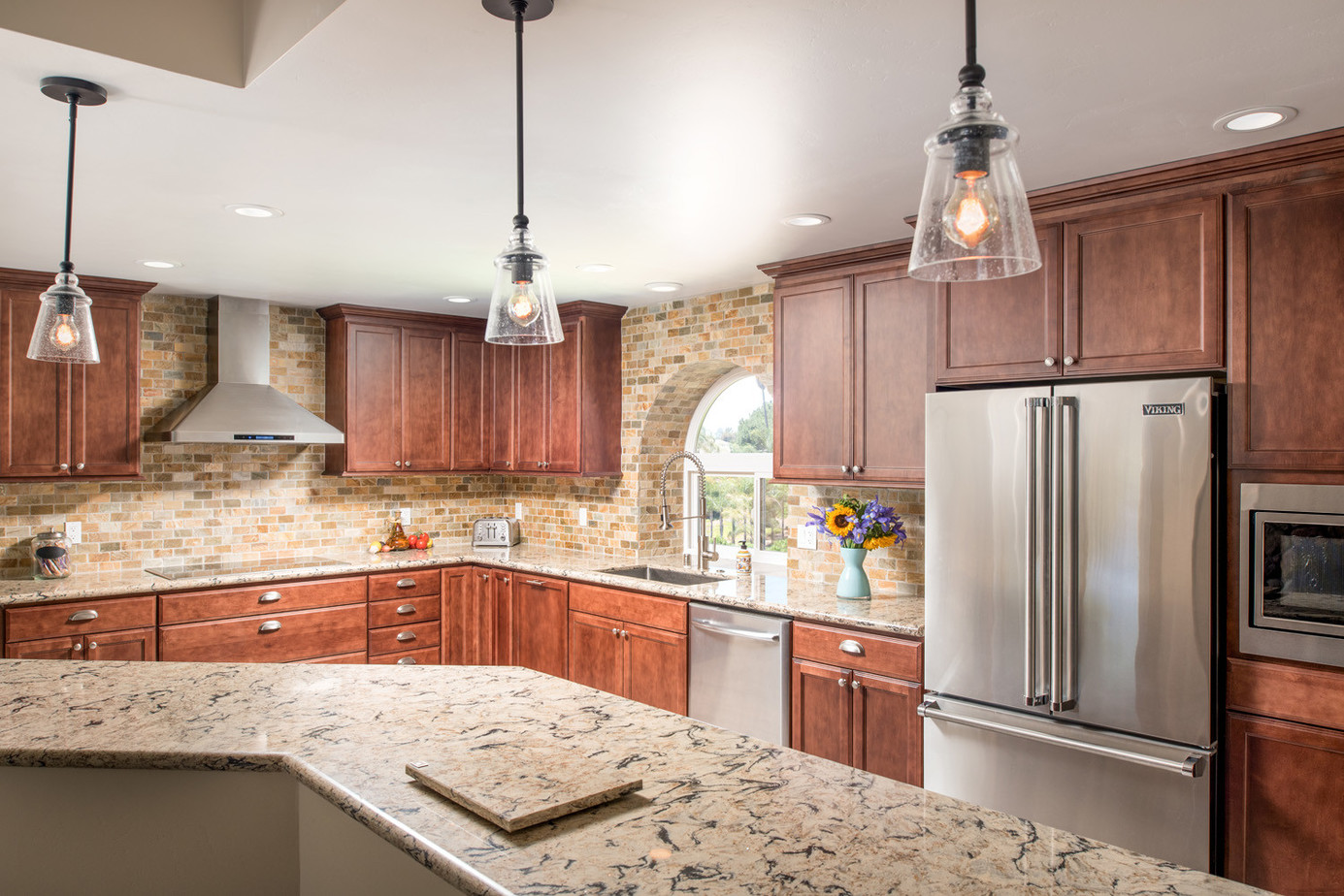 Starmark kitchen cabinets with Cambria quartz countertop and colorful tile backsplash
