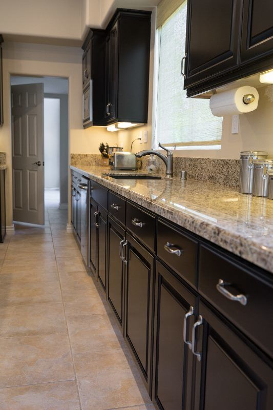 long wall of kitchen cabinets with quartz countertop