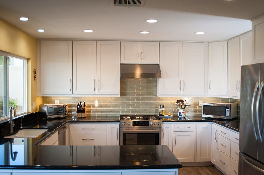 white starmark kitchen cabinets with green backsplash
