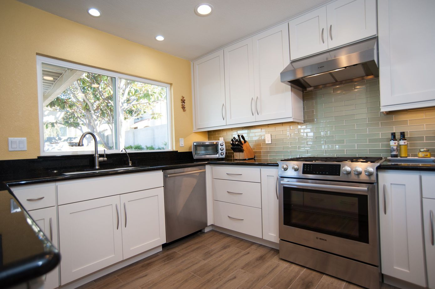 Small U Shaped Kitchen Remodel Featuring White Cabinets