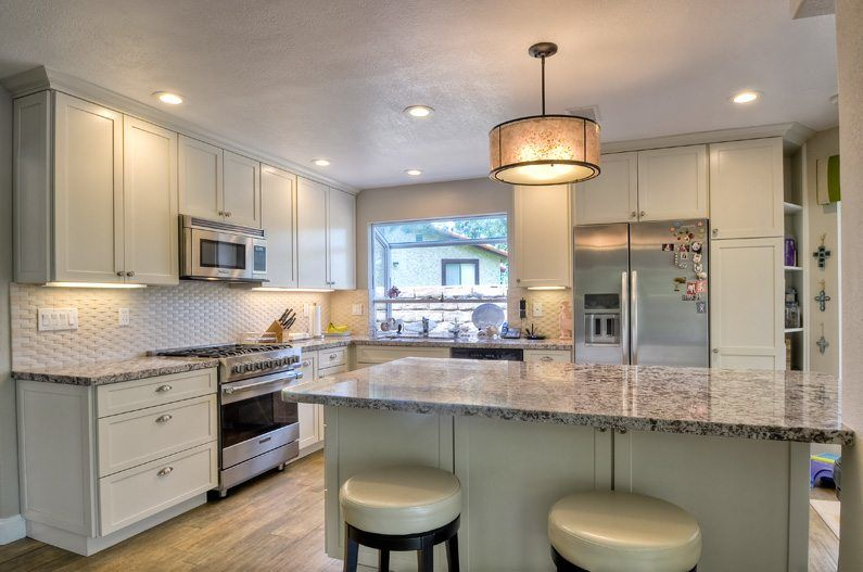 white kitchen remodel with masterbrand cabinetry