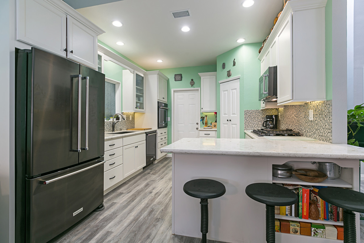 small kitchen remodel with white cabinets and easy green wall paint
