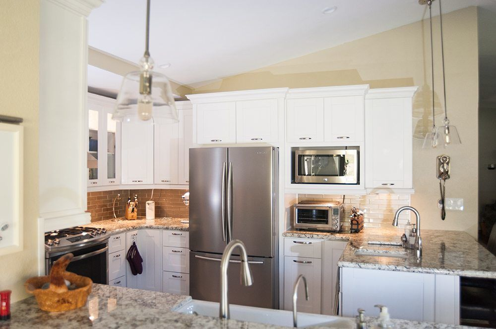 Small Kitchen Remodel With White Shaker Cabinets and Stainless Steel Refrigerator