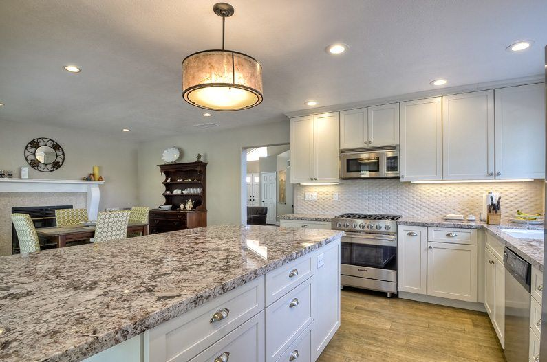kitchen remodel in vista featuring white cabinetry and granite countertops