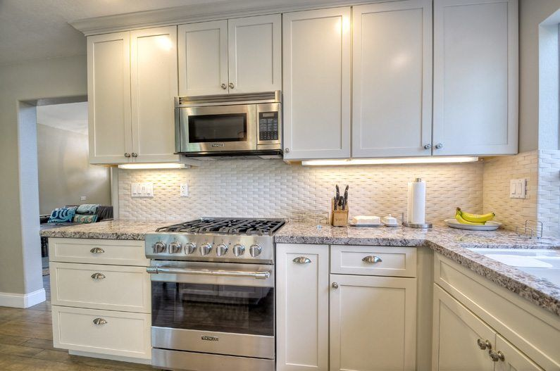 granite countertops with white kitchen cabinets in a kitchen remodel located in vista ca