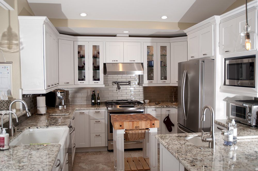 White Kitchen Cabinets in Small U Shaped Kitchen Remodel