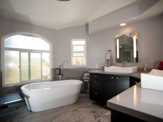 luxury master bathroom remodel in poway featuring a steam shower and free standing tub