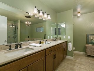 green bathroom remodel in carlsbad with starmark cabinets