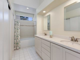 small master bathroom remodel with white cabinetry and all neutral colors