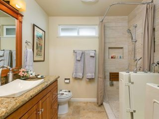 bathroom remodel in solana beach features a walk in tub inside a shower area