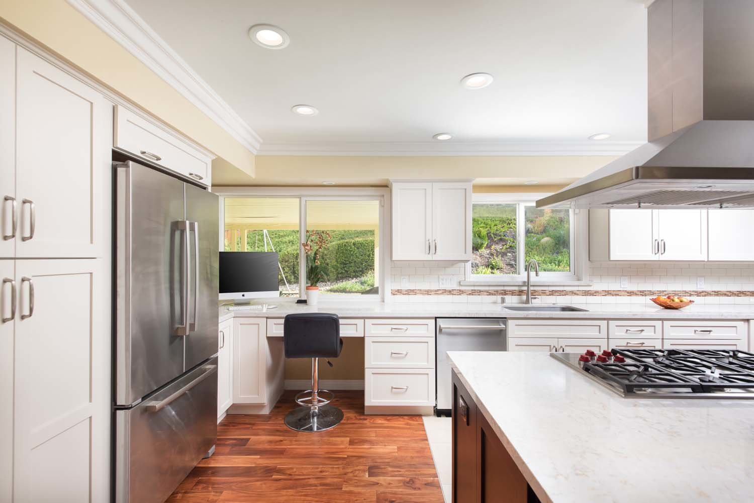 Large kitchen remodel that included adding light by adding new windows