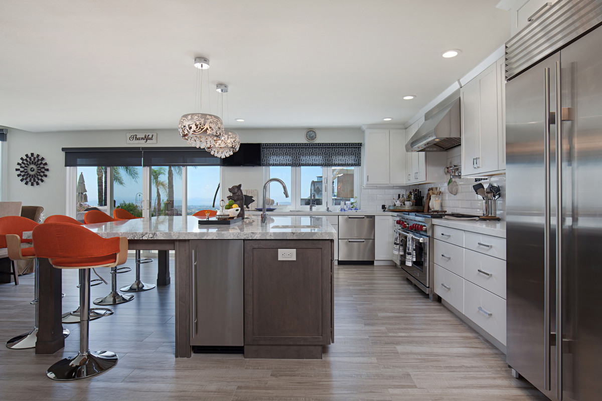 large kitchen remodel with white starmark cabinets - photo facing backyard