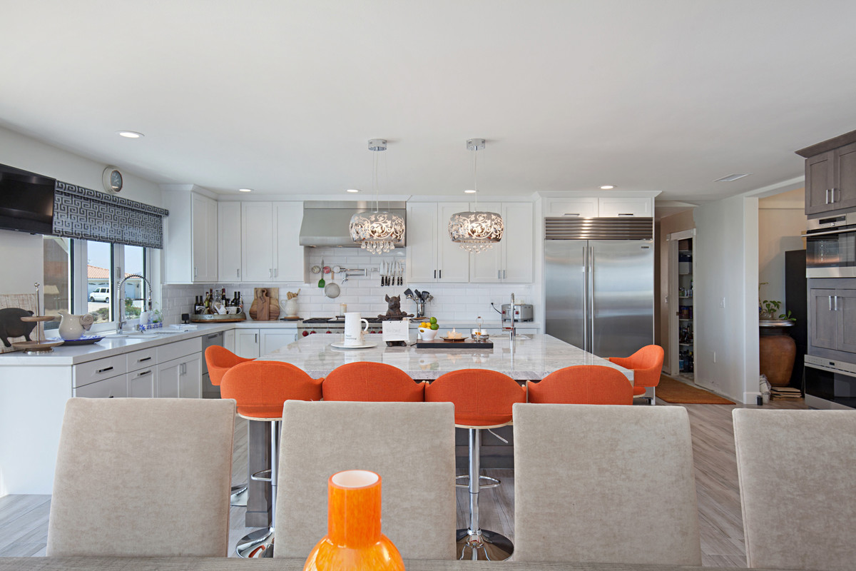 white kitchen with large island seating for 6