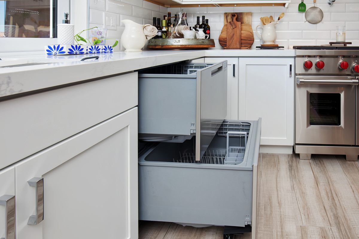 modern white kitchen with upgraded appliances including two cabinet dishwasher