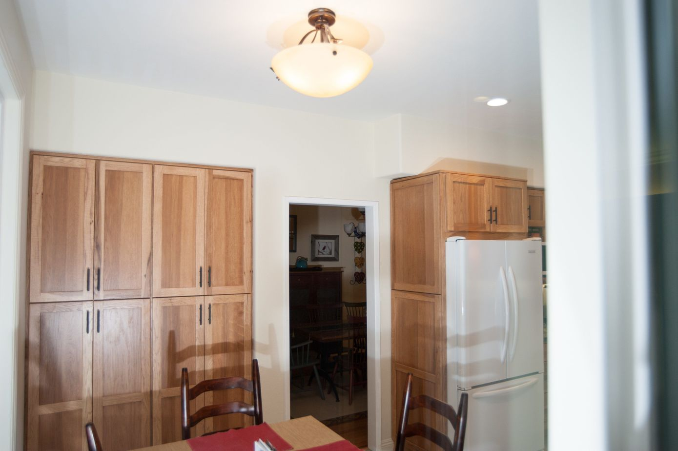 kitchen remodel with pantry area in matching wood as the kitchen cabinets