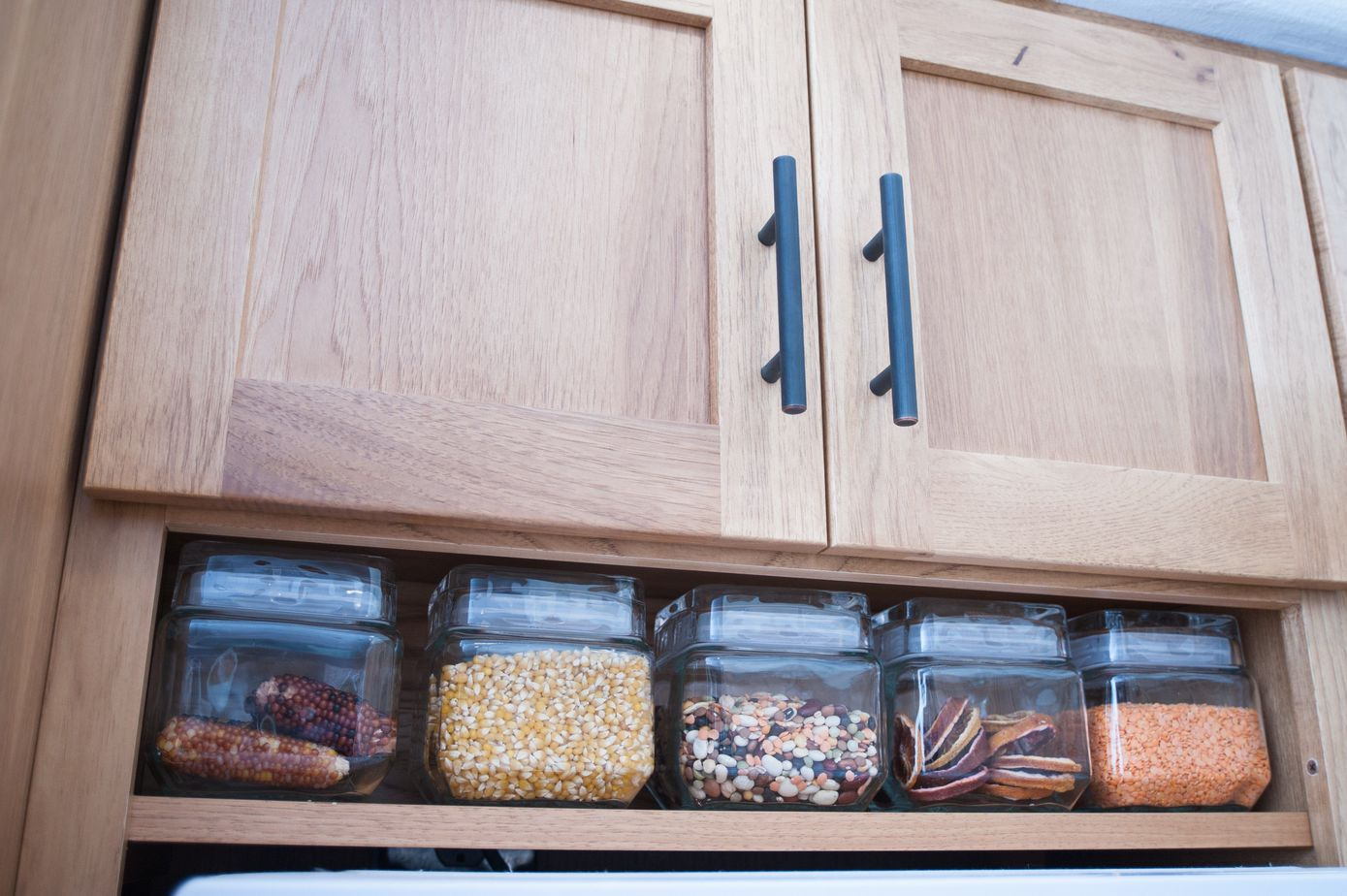 kichen cabinets with storage space for glass jars