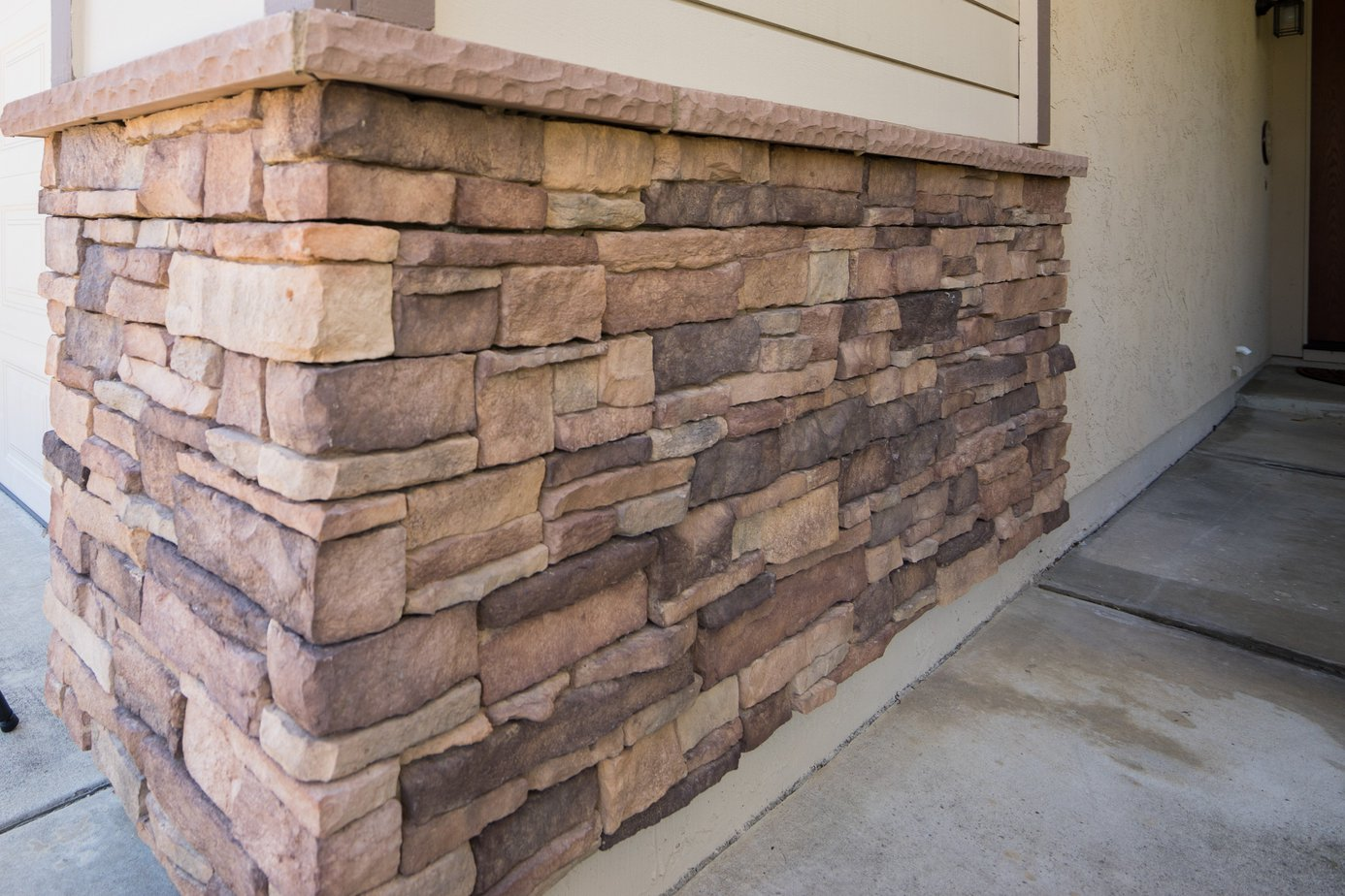 Exterior home remodel with stacked stone - Exterior paint coverage on stucco ...