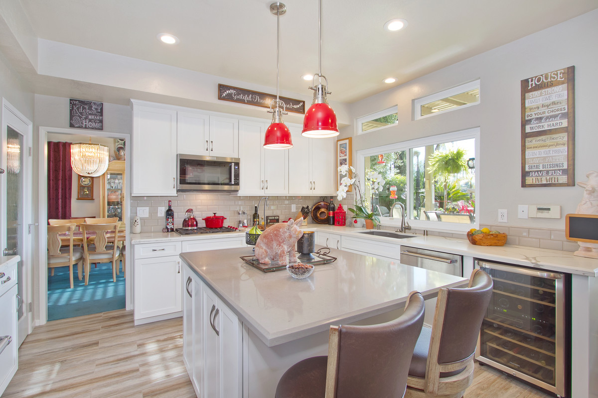 bright white kitchen with dual tone countertops